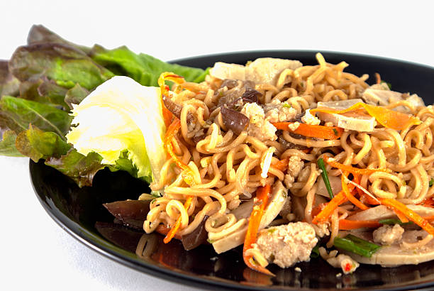 Spicy instant noodle salad with vegetable stock photo