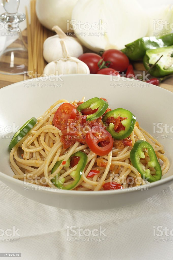 spicy italian pasta tomato and chili peppers sauce royalty-free stock photo