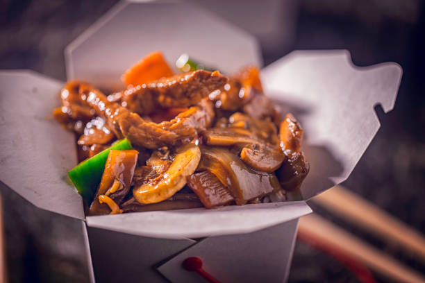 Spicy Kung Pao Chicken Spicy Kung Pao Chicken Served as Take Out Food chinese takeout stock pictures, royalty-free photos & images