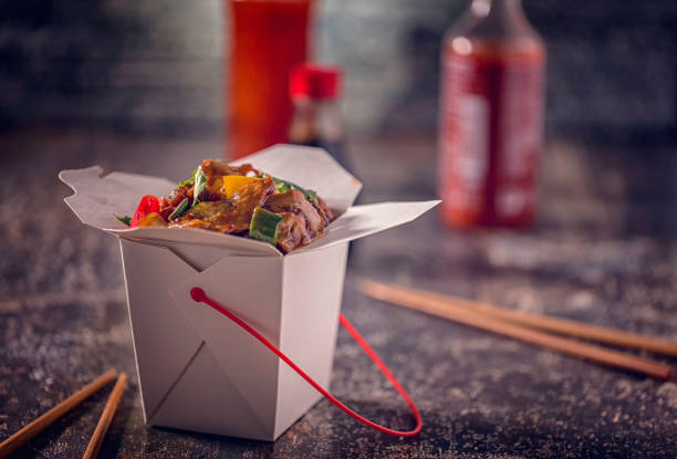 spicy kung pao chicken take out food - chinese food stock photos and pictures