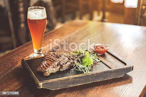 istock Spicy meat with light cold beer 687210088