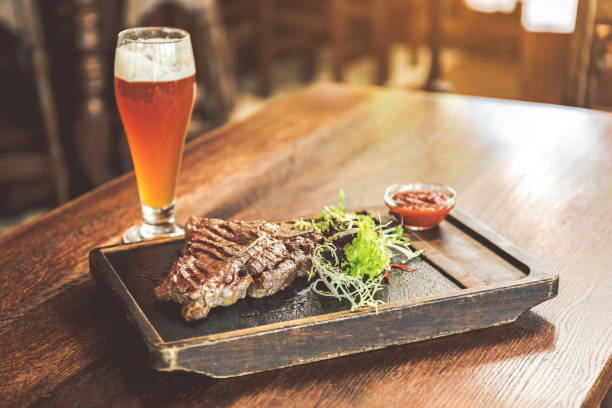Spicy meat with light cold beer stock photo