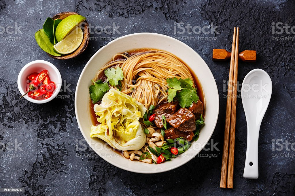 Spicy noodles in broth with Beef stock photo