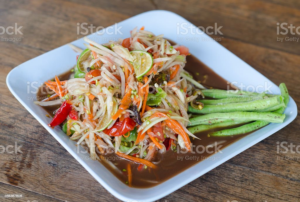 spicy papaya salad with salted crab and fermented fish stock photo