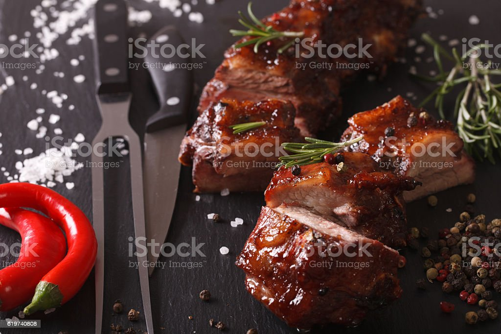 Spicy pork ribs BBQ closeup with the ingredients. horizontal stock photo
