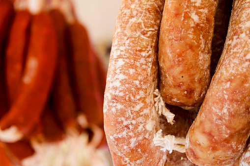 Spicy pork sausage for sale at a market stall