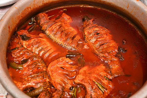 istock Spicy red hot Kerala fish curry 666202466