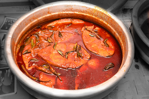 istock Spicy red hot Kerala fish curry 666202470