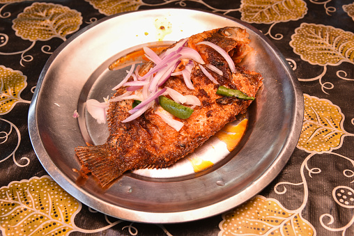 istock Spicy red hot Kerala fish curry 666202522