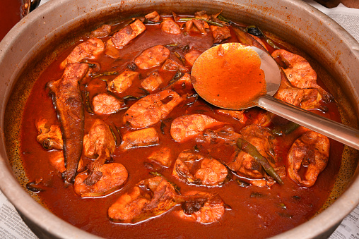 istock Spicy red hot Kerala fish curry 666202620