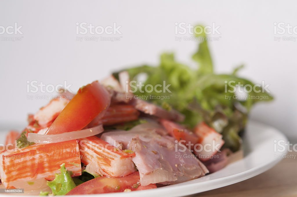 Spicy Salad Crap Stick and Smoke pork knuckle. royalty-free stock photo