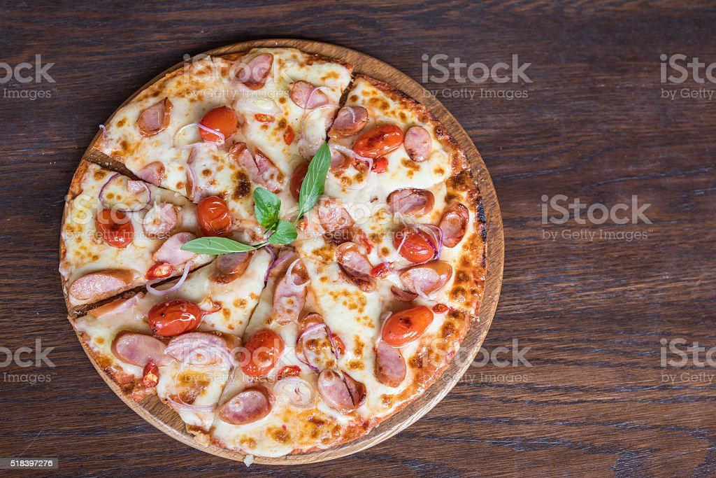 spicy sausage pizza on wooden table, Top view stock photo
