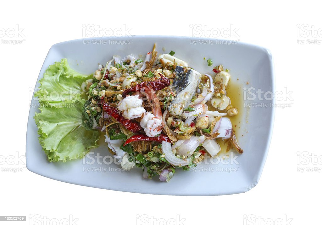 spicy seafood salad in plate on white background royalty-free stock photo