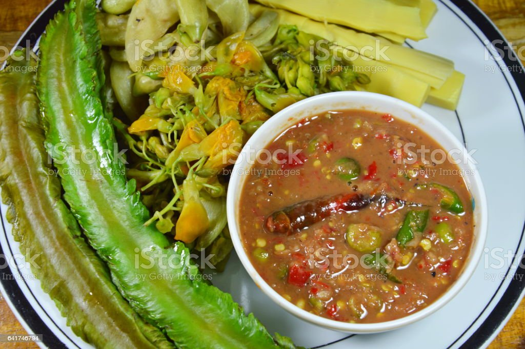 spicy shrimp paste sauce with boiled vegetable stock photo