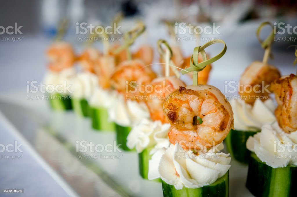 Spicy shrimp with cucumber and cream cheese skewers served on plate stock photo