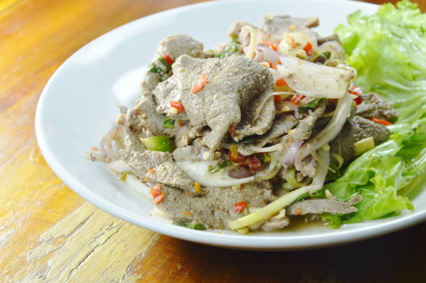 spicy slice boiled pork liver salad with herb stock photo