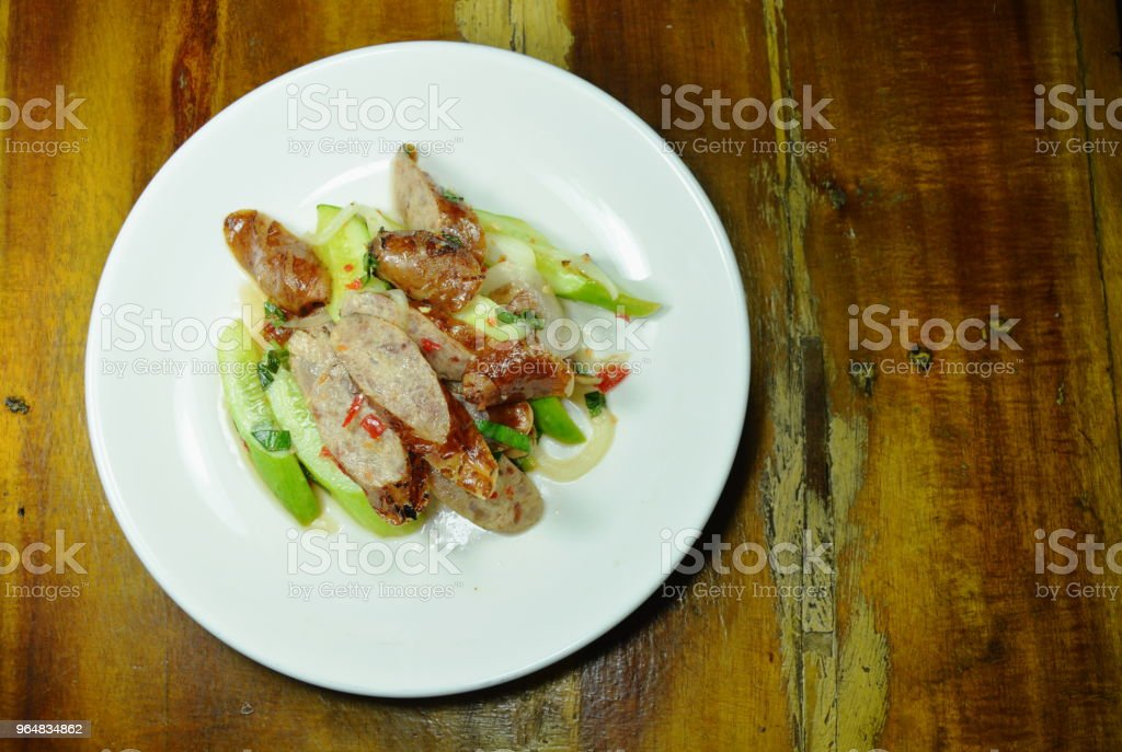 spicy slice Chinese pork sausage with cucumber Thai salad royalty-free stock photo