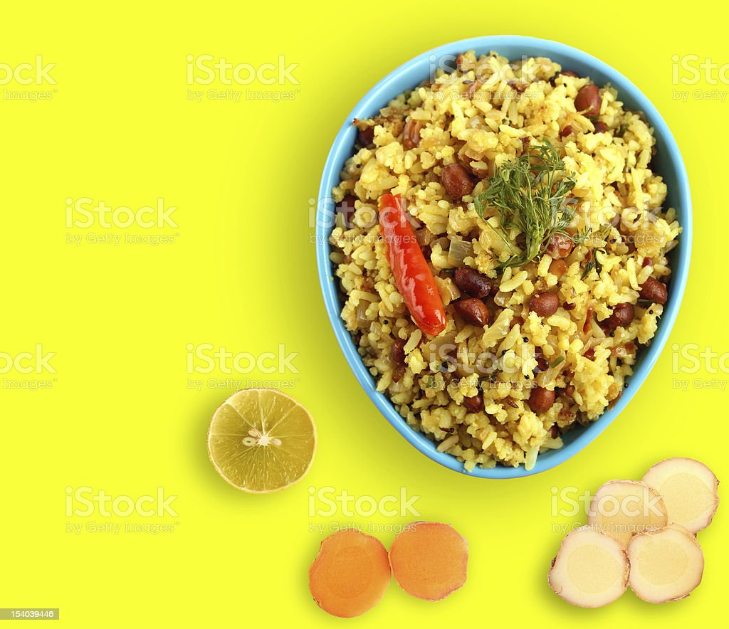 Spicy south indian breakfast chitranna or poha royalty-free stock photo