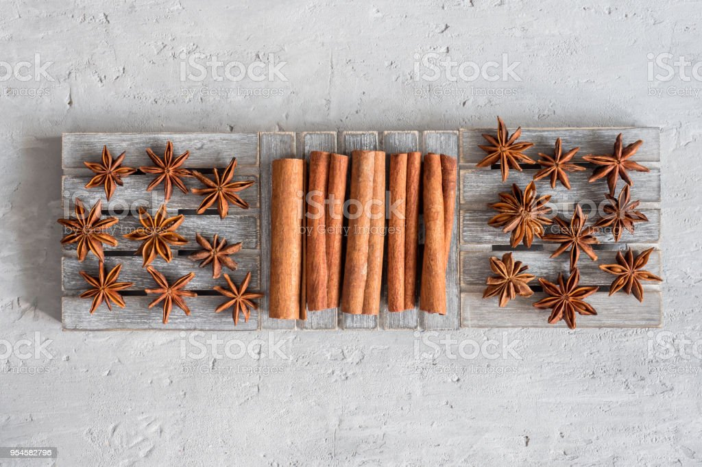 Spicy Spice Cinnamon Sticks Star Anise On Wooden Stand On Grey