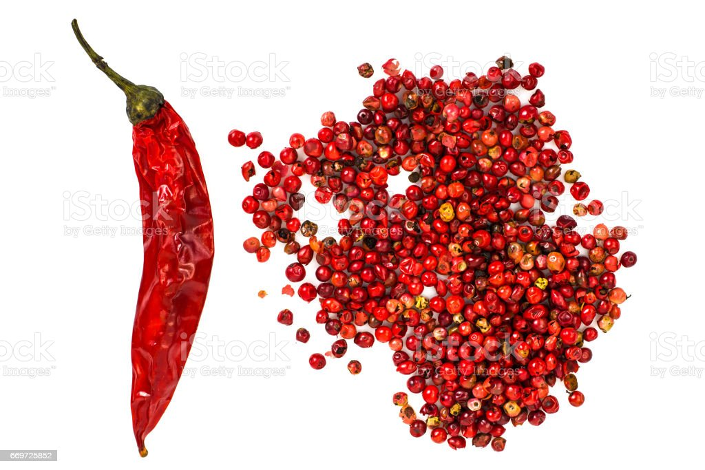 Spicy Spice Pink pepper peas on white background stock photo
