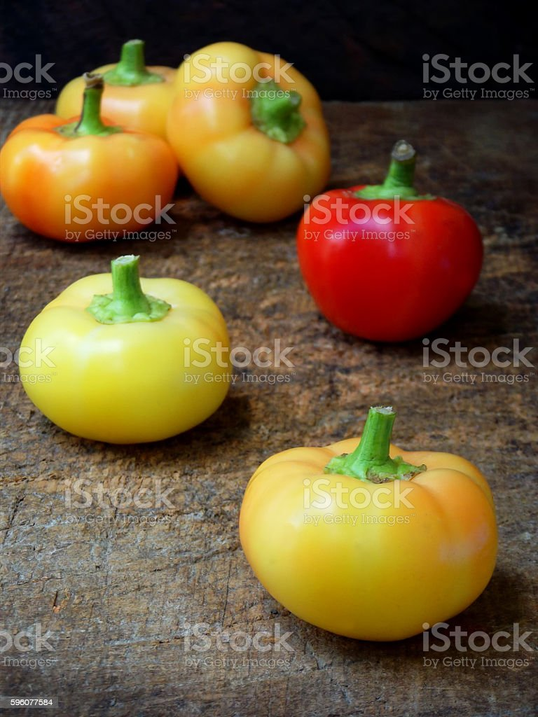 spicy yellow pepper on a wooden background. royalty-free stock photo