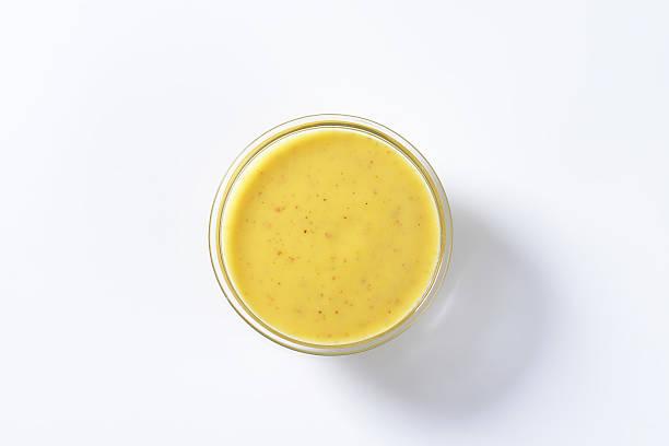 spicy yellow-sauce - sauce hollandaise stock-fotos und bilder