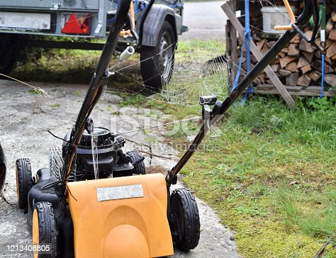 Spider web on the lawn mover tell the lazy gardener it is time to mow the lawn