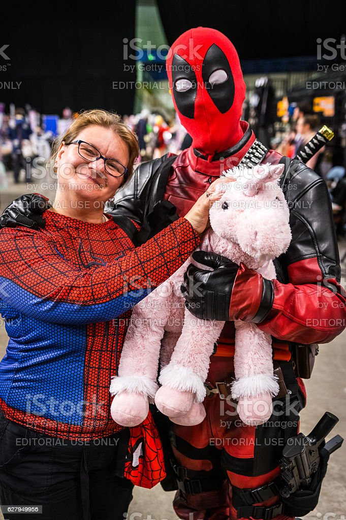 Spiderman and Deadpool cosplay stock photo
