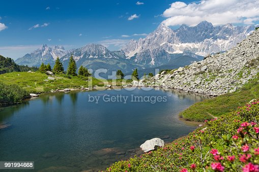 Spiegelsee with the famous Dachstein Glacier Mountains in back, Reiteralm, Schladming, Austria. Nikon D850. Converted from RAW.