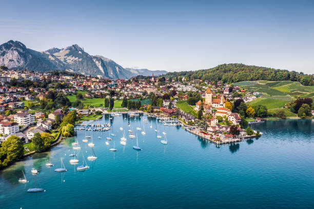 Spiez castle by lake Thun in Canton of Bern, Switzerland high angle view from drone point of Spiez town switzerland stock pictures, royalty-free photos & images