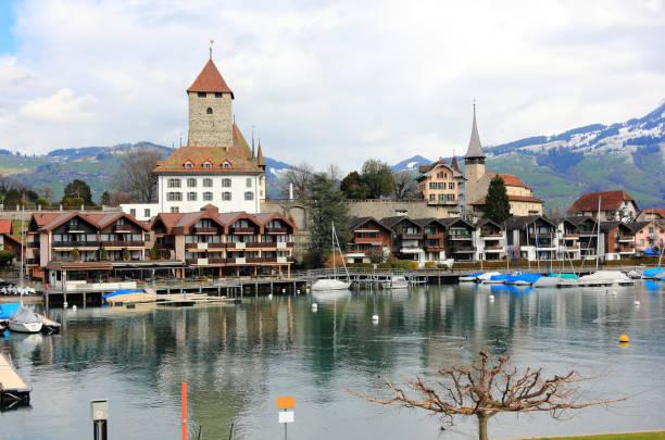 Spiez harbour, Spiez Castle and Lake Thun. Switzerland, Europe. stock photo
