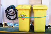 Spill kit yellow wheelie bin for health and safety of chemical, oil, diesel or petrol leak uk