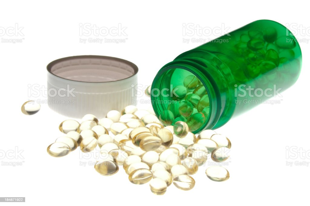 Spilled bottle of vitamins royalty-free stock photo
