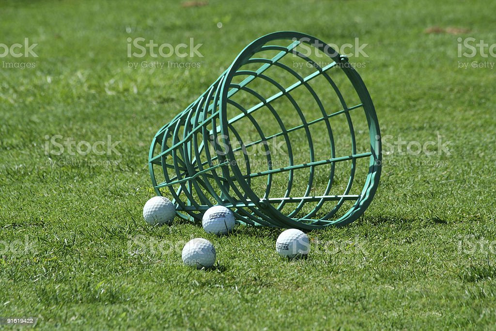 Spilled bucket of practice golf balls stock photo