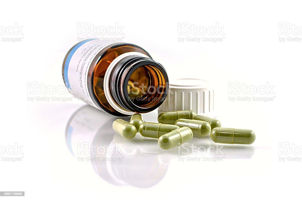 Spilled capsules from orange prescription bottle. stock photo