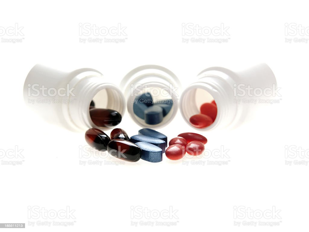 Spilled Capsules From White Bottles royalty-free stock photo