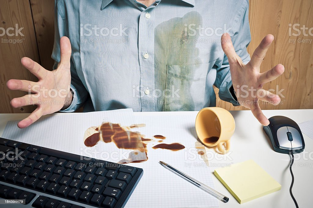 Spilled Coffee And Office Worker Sitting On The Desk stock photo