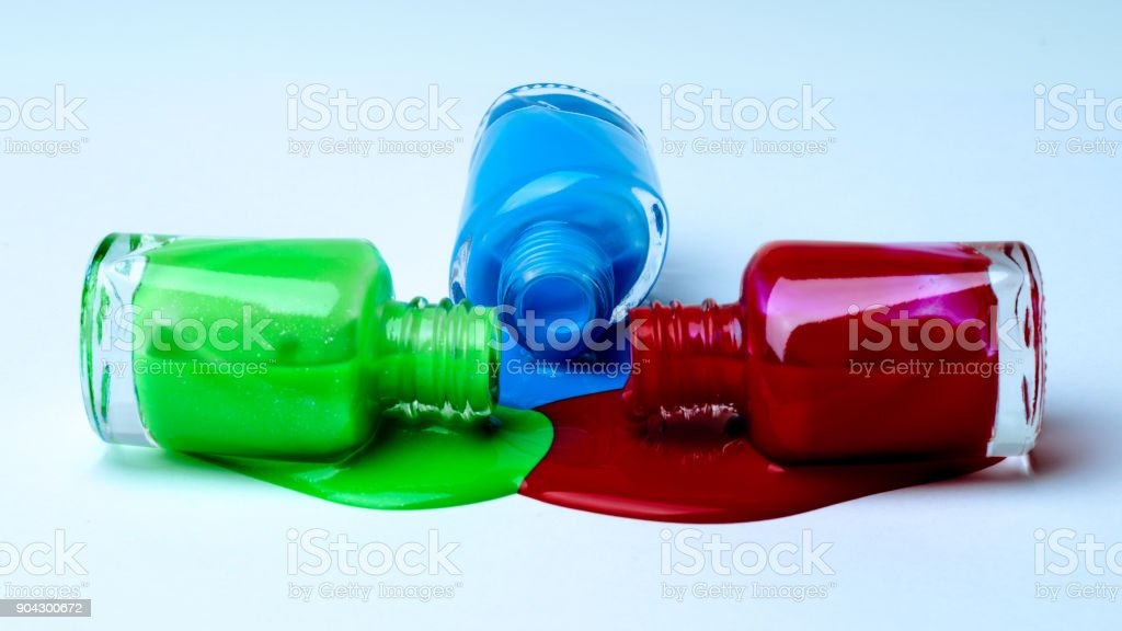 Spilled green, blue and red nail polish. stock photo