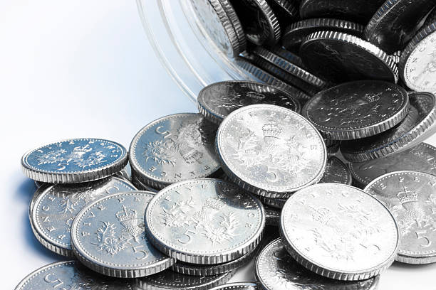 Spilled Jar of Coins stock photo