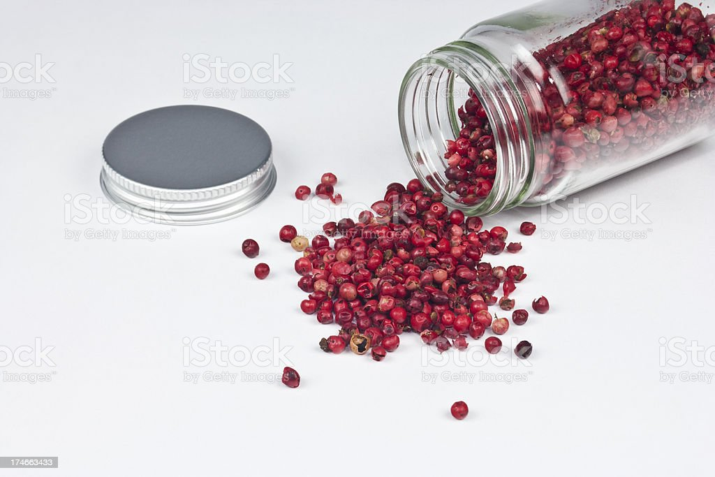 Spilled Jar of Red Peppercorns stock photo