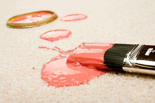 Spilled Paint on Carpet Insurance Claim Accident stock photo