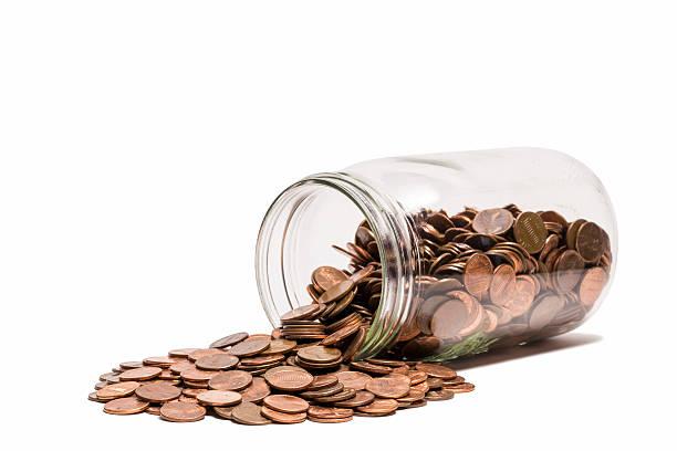 Spilled Penny Jar stock photo