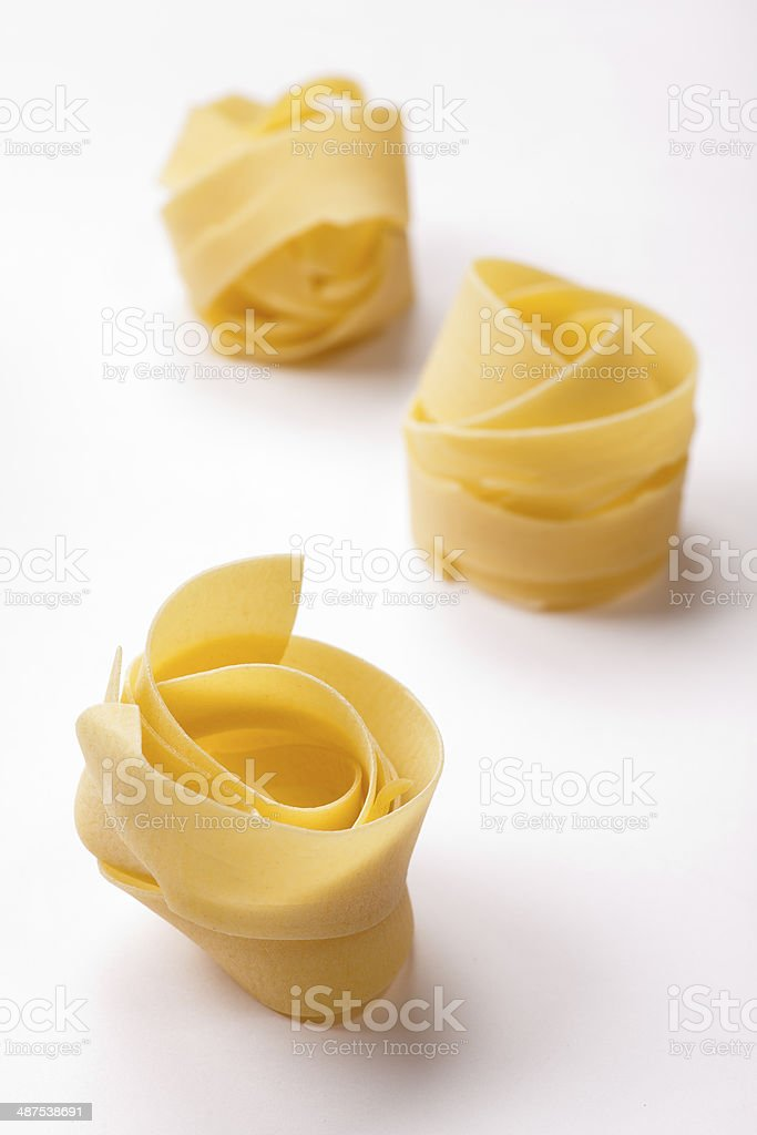 Spilled raw pappardelle pasta stock photo