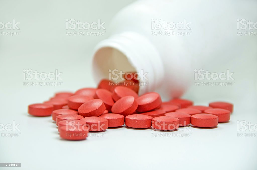 Spilled Red Pills stock photo