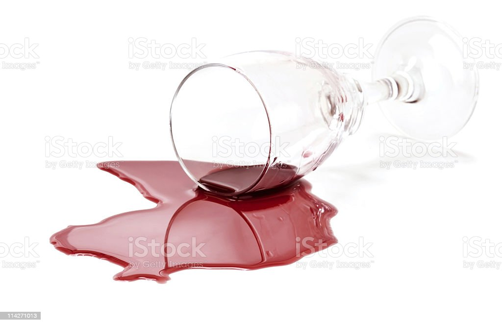 Spilled red wine glass stock photo