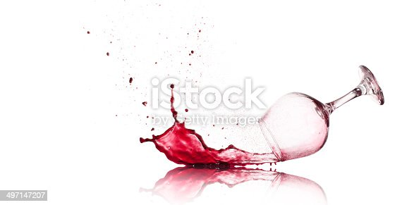 Red Wine Glass spilling and splashing.