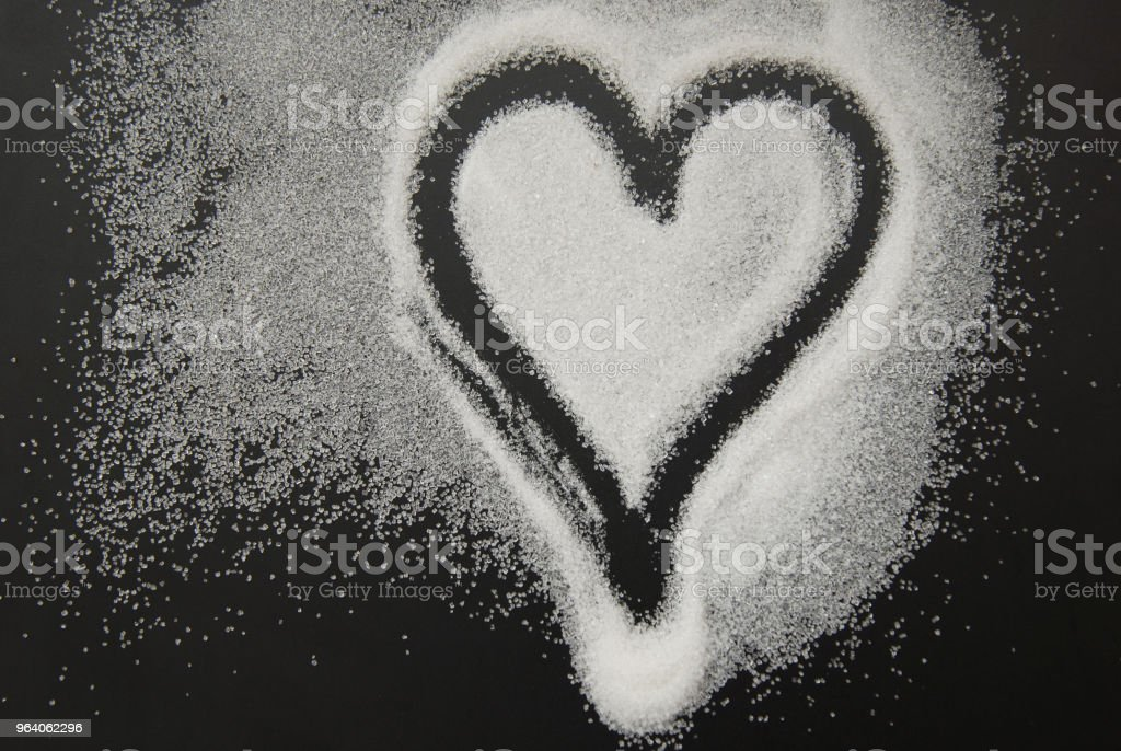 Spilled Sugar Heart Love Shape of Heart Black Background. unhealthy sugar. Love sugar Sweet. - Royalty-free Abstract Stock Photo