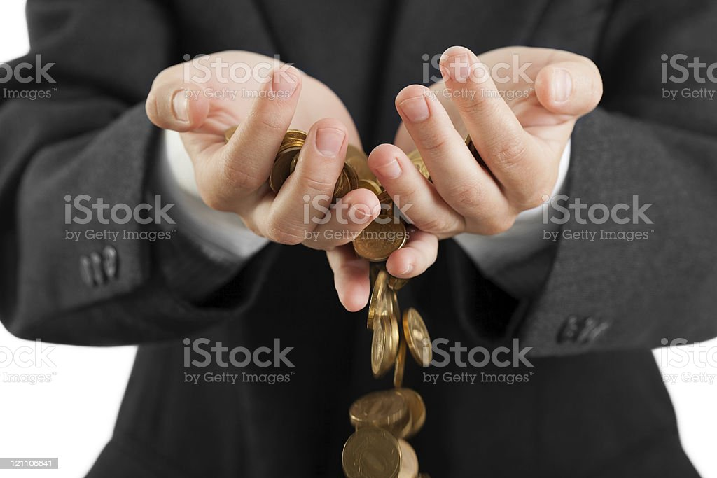 Spilling coins in hands stock photo