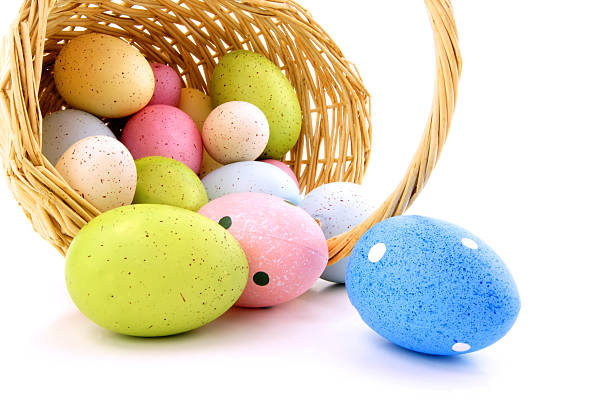 Spilling eggs from an Easter basket stock photo