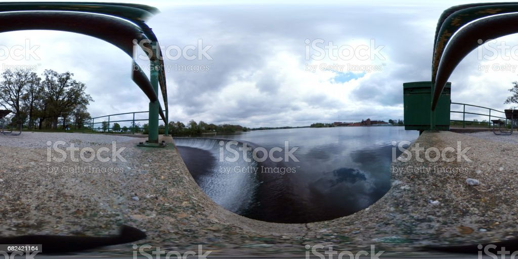Spillway area of Lake Bloomington, a city owned reservoir , after a soaking springtime storm the night before.  This file was taken with a Samsung 360 camera.  Placed in the correct software, it will rotate the view 360 degrees. royalty-free stock photo